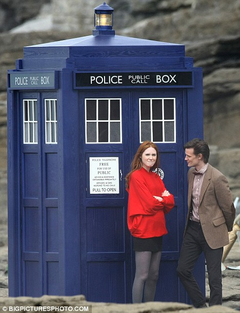 Gillan and Smith on set with the retro-feel TARDIS.