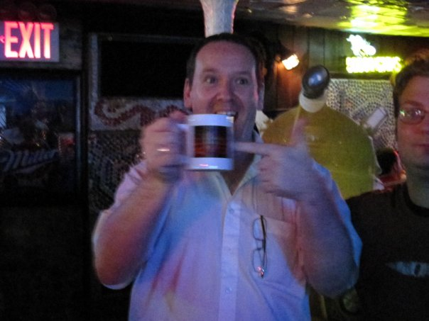 """Gary Russell sports his new Radio Free Skaro """"Action by HAVOC"""" mug for the DWNY crowd."""